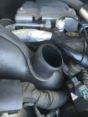 Lift and remove the resonator plenum from the intake tube.